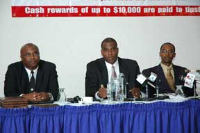 Darrin Carmichael and members of the head table field questions from the media